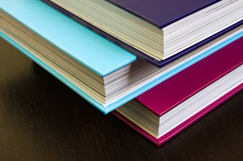 Thick encyclopedias with colorful hardcovers by Horia Varlan